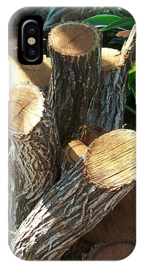 Logs IPhone X Case featuring the photograph Landscaper Art by Laurette Escobar