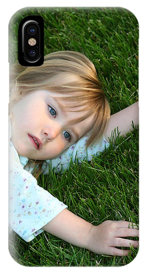 Girl IPhone X Case featuring the photograph Lying In The Grass by Margie Wildblood