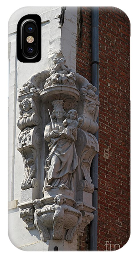 Madonna IPhone X Case featuring the photograph Madonna And Child Statue On The Corner Of A House In Bruges by Louise Heusinkveld