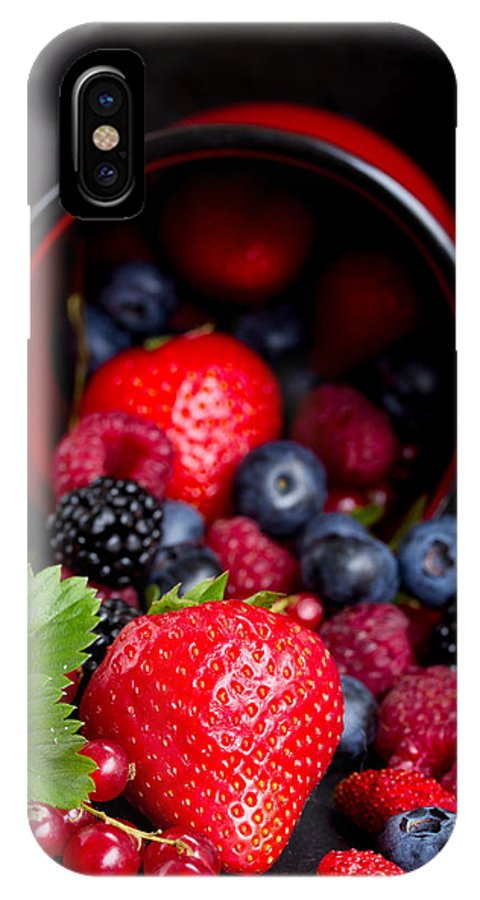 Currant IPhone X Case featuring the photograph Mug With Fresh Berries by Anastasy Yarmolovich