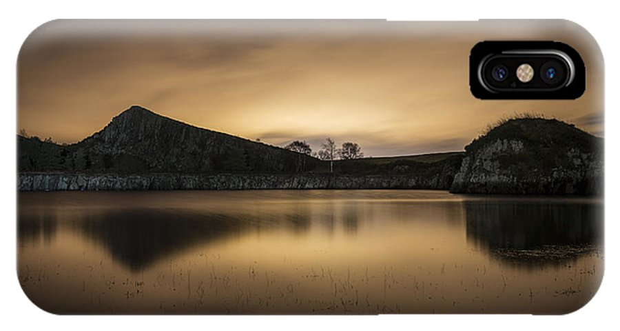 Britain IPhone X / XS Case featuring the photograph Night At Cawfields by David Taylor
