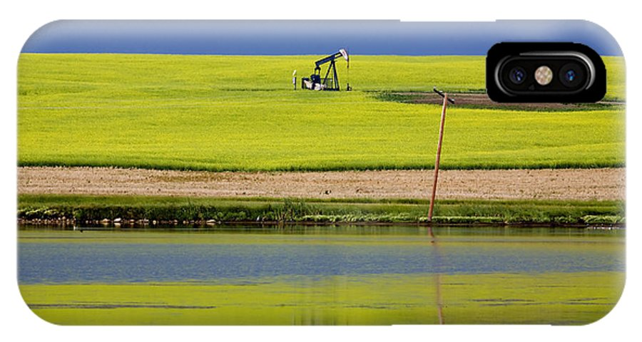 Industry IPhone X Case featuring the photograph Oil Jack Reflection Saskatchewan by Mark Duffy