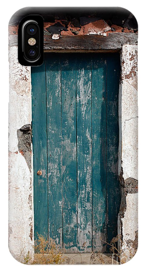 Abandoned IPhone Case featuring the photograph Old Painted Door by Gaspar Avila
