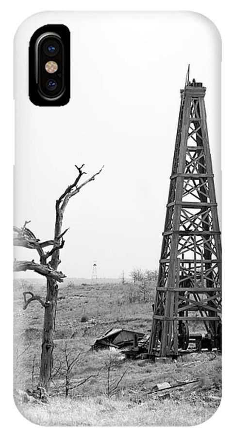 Oil Field IPhone X Case featuring the photograph Old Wooden Oil Derrick by Larry Keahey