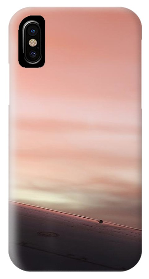 IPhone X Case featuring the photograph On The Edge Of The Wing by Kevin Cote