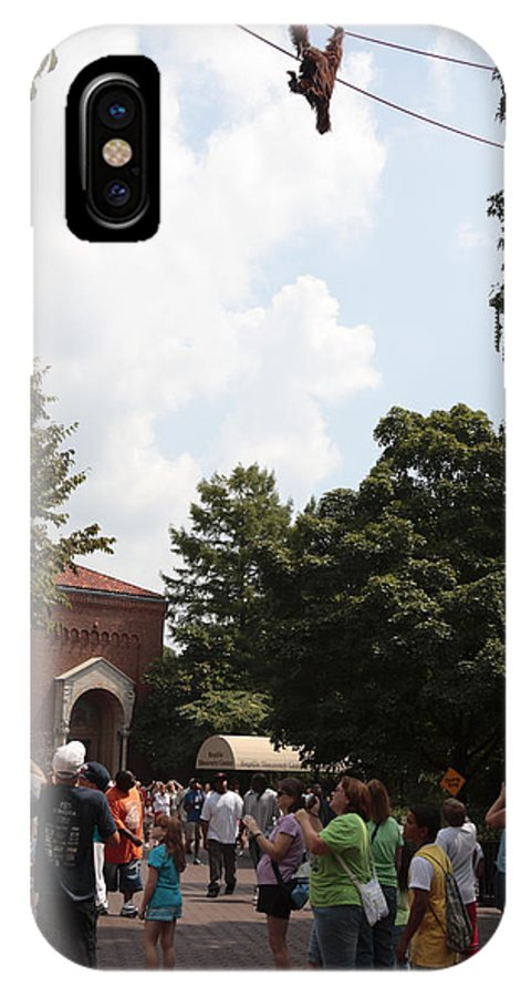 Cable IPhone X Case featuring the photograph Orangutan Swings Over Tourists At The National Zoo In Washington by William Kuta