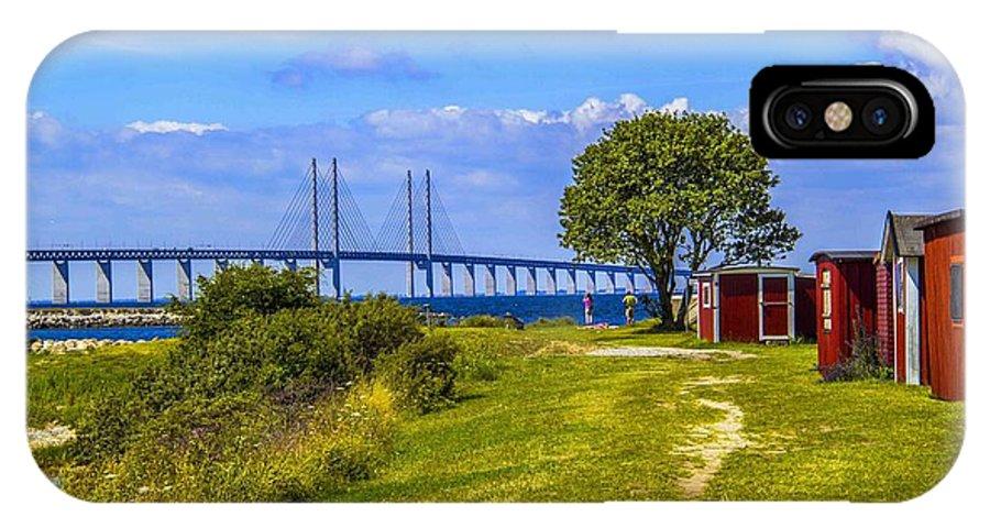 Cabanas IPhone X Case featuring the photograph Oresund Bridge With Cabanas by Roberta Bragan
