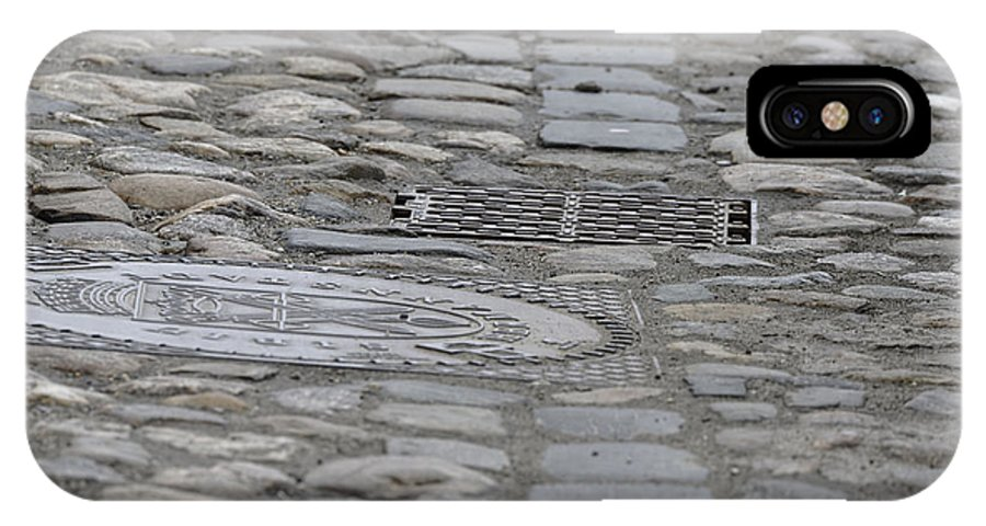 Abstract IPhone X Case featuring the photograph Paving of river rock and manhole covers cast iron by Adrian Bud