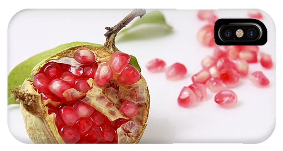 Pomegranate IPhone X Case featuring the photograph Pomegranate And Seeds by Yedidya yos mizrachi