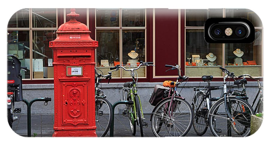 Postbox IPhone X Case featuring the photograph Postbox And Bicycles In Front Of The Diamond Museum In Bruges by Louise Heusinkveld