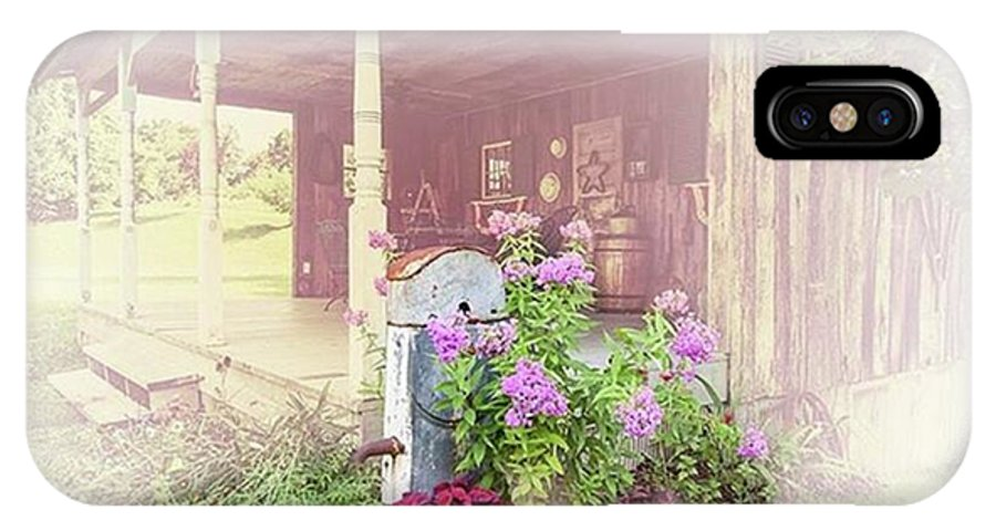 Ruralphotography IPhone X Case featuring the photograph Pump With Flowers Brazeau by Larry Braun
