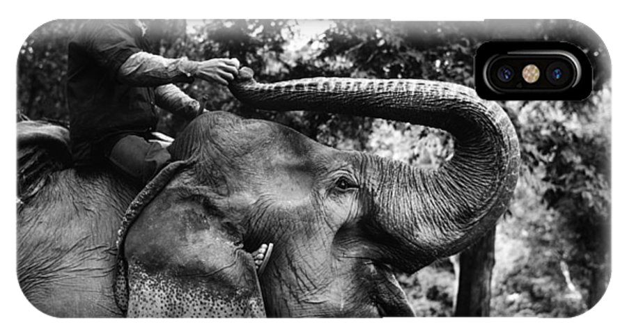 Man IPhone X / XS Case featuring the photograph Riding The Elephant by Carl Purcell