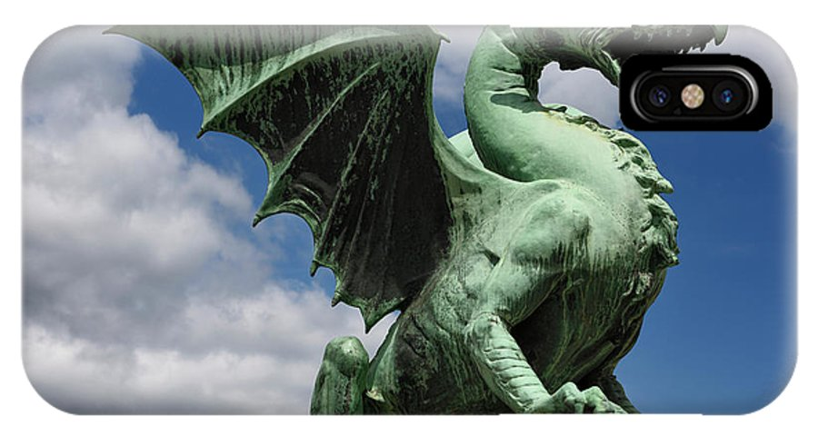 Dragon IPhone X Case featuring the photograph Roaring Winged Dragon Sculpture Of Green Sheet Copper Symbol Of by Reimar Gaertner