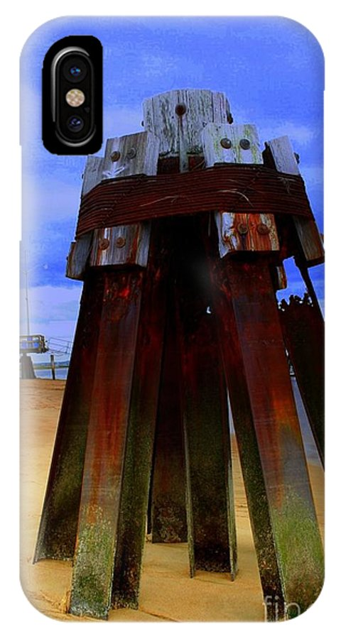 Plum Island IPhone X / XS Case featuring the photograph Rusty Pillars by John Kenealy