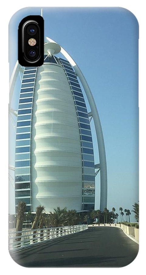 IPhone X Case featuring the photograph Sail-shaped Silhouette Of Burj Al Arab Jumeirah by Chris Hood