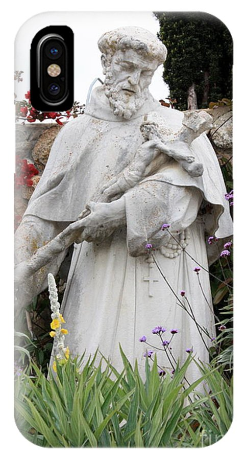 Saint Francis IPhone X Case featuring the photograph Saint Francis Statue In Carmel Mission Garden by Carol Groenen