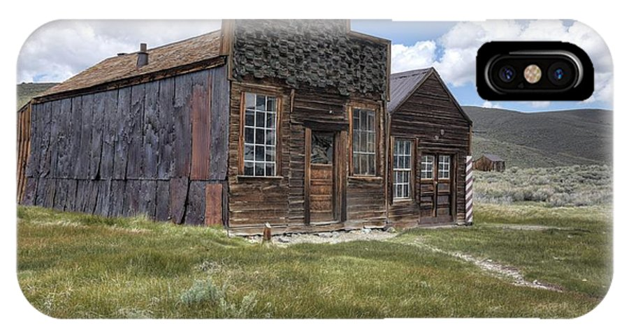 Old Rustic Historic Memories 1800's Schools Churches Bars Mercantile Blacksmith Livery Stables Nature Grass Foothills Color Red Green Blur Sky Clouds Bodie Mining Town Northern California IPhone X Case featuring the photograph Sam Leon Bar And Barber Shop by Thomas Todd