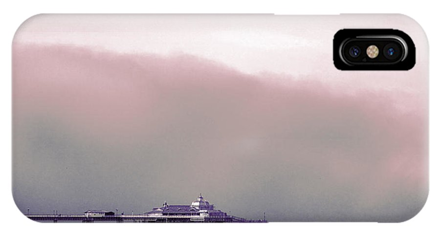 Pier IPhone X Case featuring the photograph Sea Mist Replaces The Great Orme As The Backdrop To Llandudno Pier by Mal Bray
