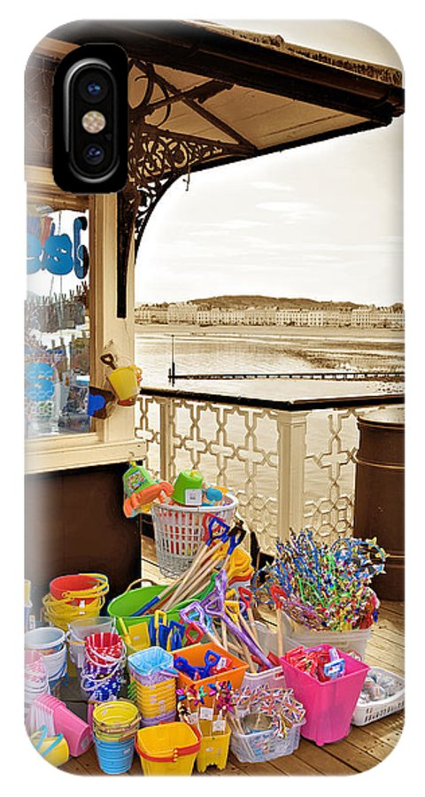 Seaside IPhone X Case featuring the photograph Seaside Buckets And Spades For Sale On Llandudno Pier by Mal Bray