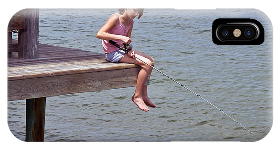 Fish; Fishing; Fisherman; Fisherwoman; Fishergirl; Girl; Florida; Brevard; Indian; River; Space; Coa IPhone X Case featuring the photograph Serious Fishergirl On The Indian River In Florida by Allan Hughes