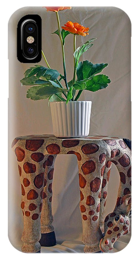 Giraffe; Burden; Flower; Pot; Orange; Artificial; Animal; Stuffed; Ceramic; Statue; Figurine; Figure IPhone X Case featuring the photograph Servant Giraffe by Allan Hughes