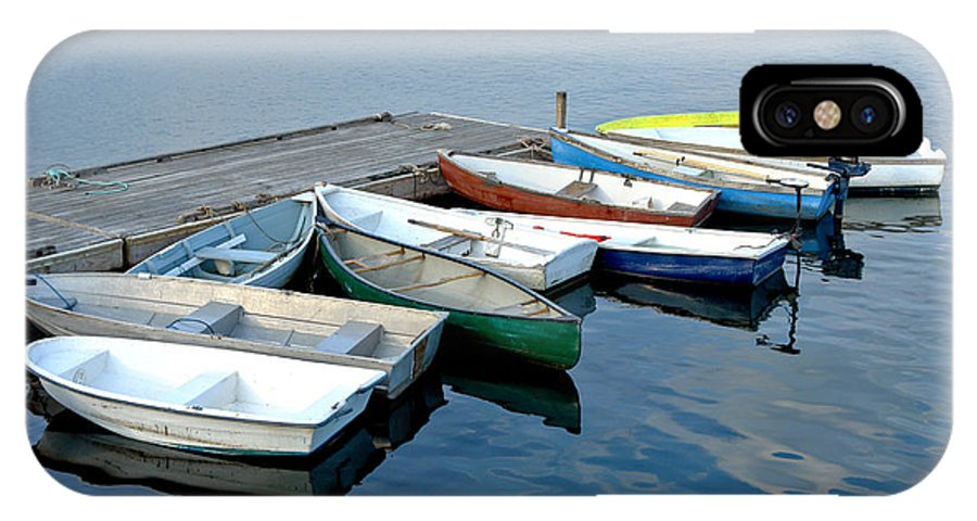 Flotilla IPhone X Case featuring the photograph Small Boats Docked To A Pier by Olivier Le Queinec