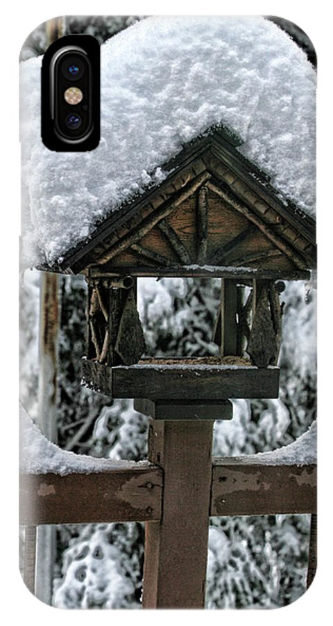 Snowy IPhone X Case featuring the photograph Snowy Feeder by Bonnie Bruno