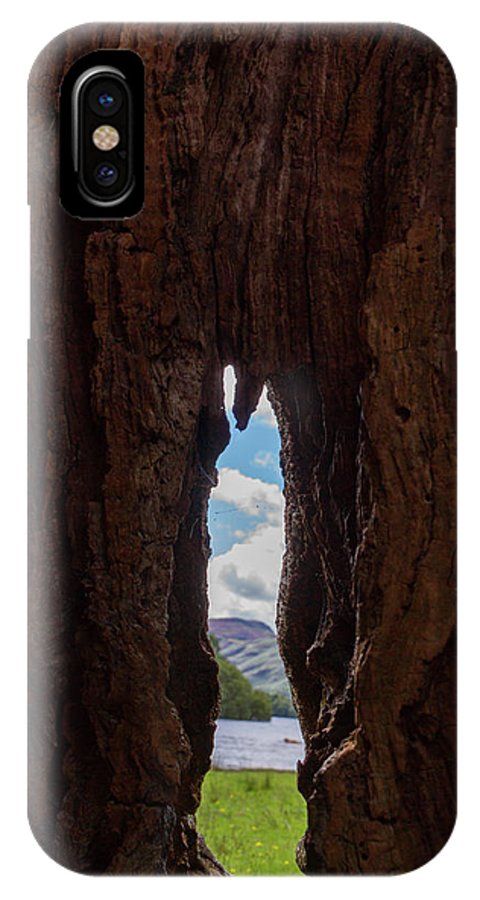Cumbria Lake District IPhone X Case featuring the photograph Spot The Lake Shore View Through The Hollow Tree Trunk by Iordanis Pallikaras