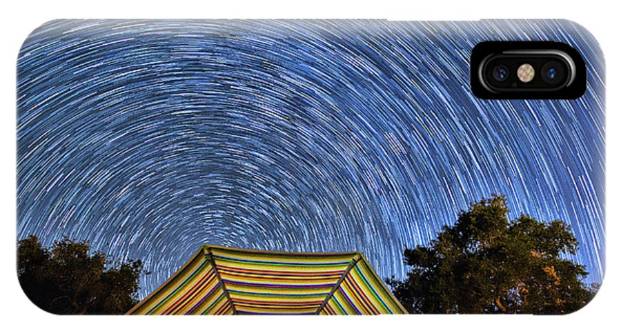 Stars IPhone X Case featuring the photograph Star Trails Over The Umbrellas by Mimi Ditchie