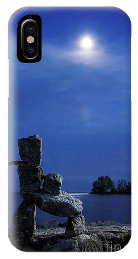 Inukshuk IPhone X Case featuring the photograph Stone Figure In Moonlight by Oleksiy Maksymenko