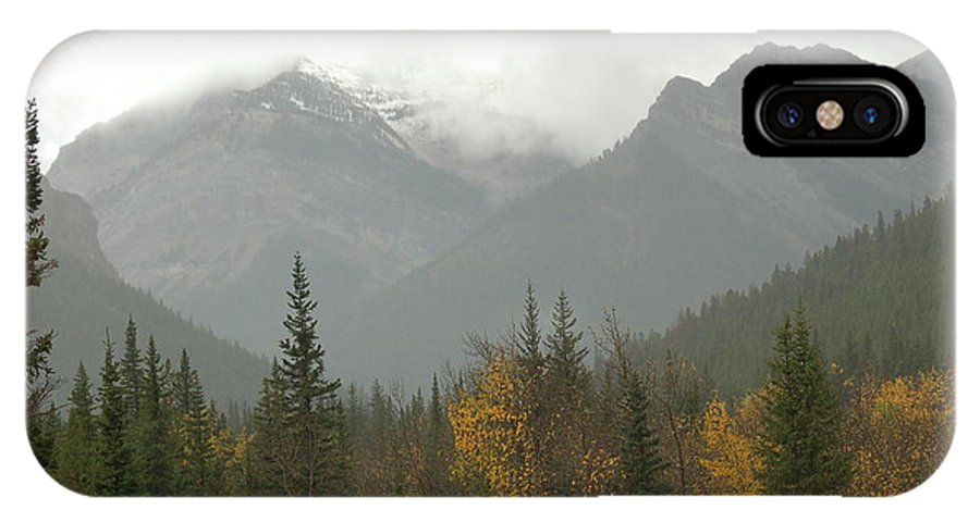 Misty IPhone X Case featuring the photograph Storm in the Mountains by D Nigon
