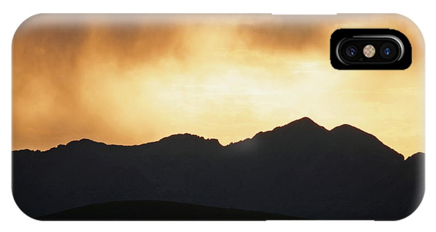Landscape IPhone X Case featuring the photograph Stormy Sunset by Gregory Yost