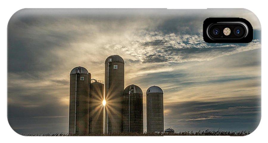 Sun IPhone X Case featuring the photograph Sun Burst Silos by Travis Boyd