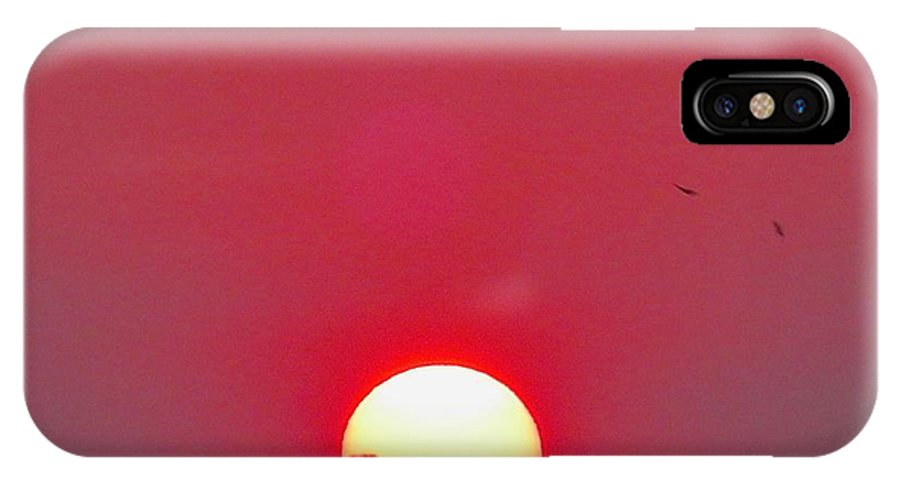 Sun IPhone X Case featuring the photograph Sun Setting by Joe Wyman