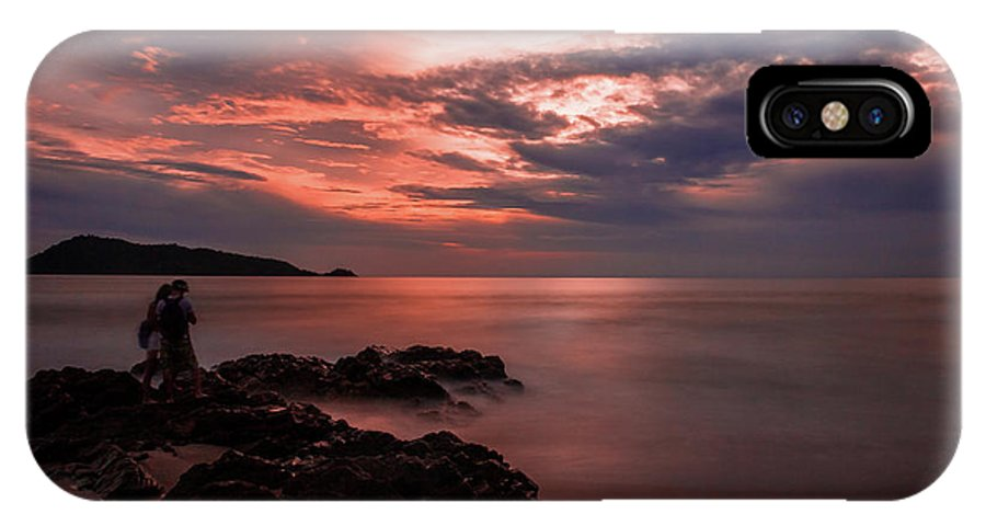 Patong IPhone X Case featuring the photograph Sunset Couple by Sayantan Sen