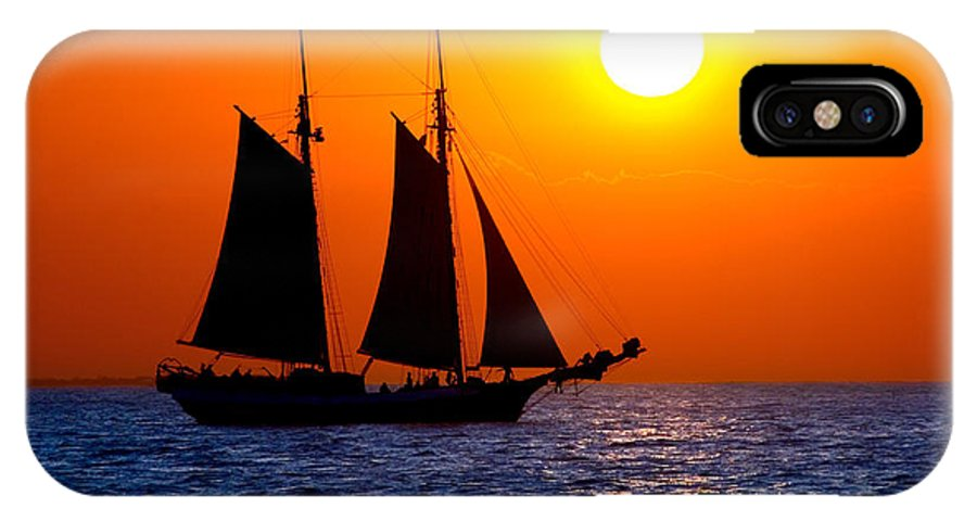 Yellow IPhone X / XS Case featuring the photograph Sunset Sailing In Key West Florida by Michael Bessler