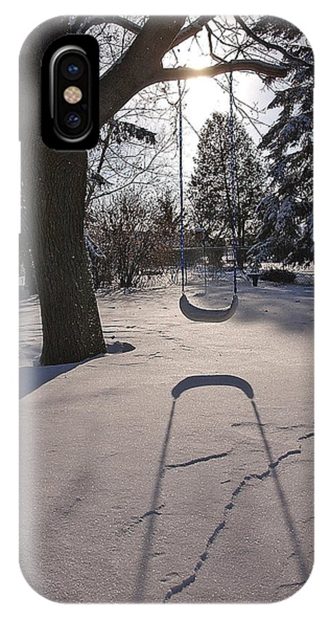 Swings IPhone Case featuring the photograph Swing Shadow On Snow by Steve Somerville