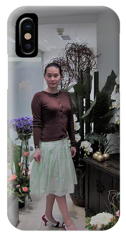 The Young Woman Enjoys Her Moment In A Floral Store In Spring Time In 2005 IPhone X Case featuring the photograph The Beautiful Young Woman by Connie Du