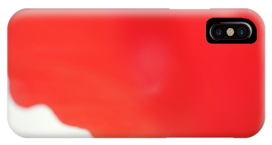 Face IPhone X Case featuring the photograph The Face In The Red Hibiscus by Roger Mullenhour