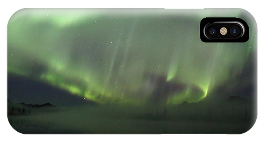 Northern Lights IPhone X Case featuring the photograph The Northern Lights Over The Denali Highway's Twin Lakes by Steve Wolfe