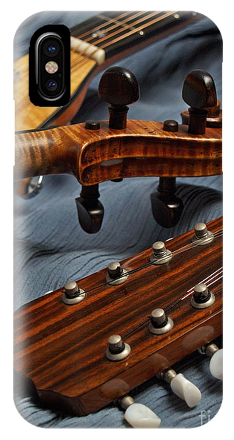 Guitar IPhone X / XS Case featuring the photograph Three Musical Instrument Heads On Blue by Anna Lisa Yoder
