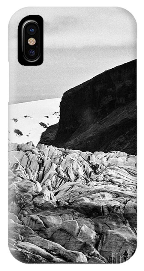 Skaftafellsjokull IPhone X / XS Case featuring the photograph tourist couple at the end of Skaftafell glacier Vatnajokull national park in Iceland by Joe Fox