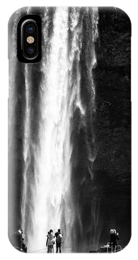 Seljalandsfoss IPhone X / XS Case featuring the photograph tourists pose for photographs in front of Seljalandsfoss waterfall iceland by Joe Fox