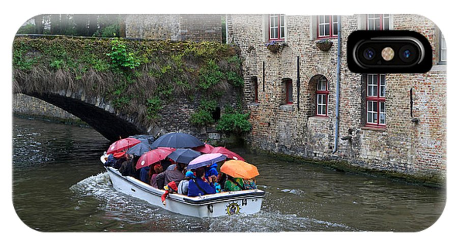 Tourists IPhone X Case featuring the photograph Tourists With Umbrellas In A Sightseeing Boat On The Canal In Bruges by Louise Heusinkveld