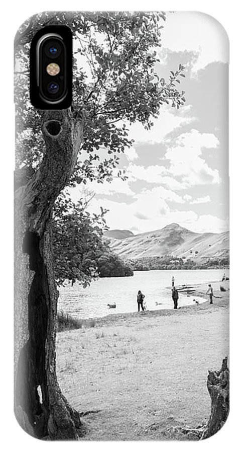 Cumbria Lake District IPhone X Case featuring the photograph Tree And People By The Lake by Iordanis Pallikaras