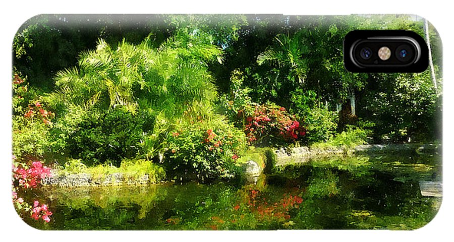 Garden IPhone X Case featuring the photograph Tropical Garden By Lake by Susan Savad