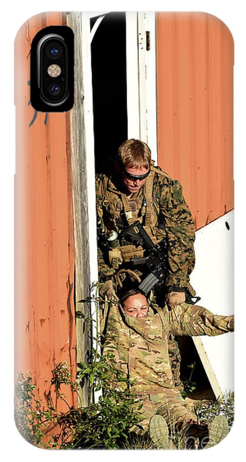 Exercise Emerald Warrior IPhone X Case featuring the photograph U.s. Marine Drags An Injured Patient by Stocktrek Images
