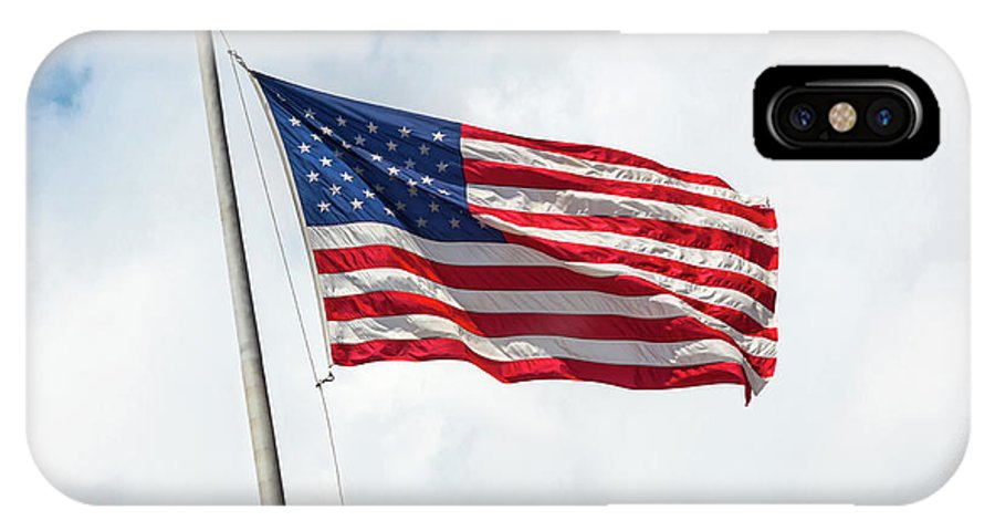 Usa IPhone X / XS Case featuring the photograph Usa Flag On Blue Sky With Clouds by Antonio Gravante