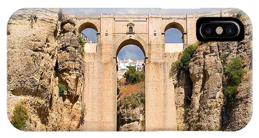 Ronda IPhone X Case featuring the photograph View Of The Tajo De Ronda And The Puente Nuevo Bridge From Across The Valley by Mal Bray