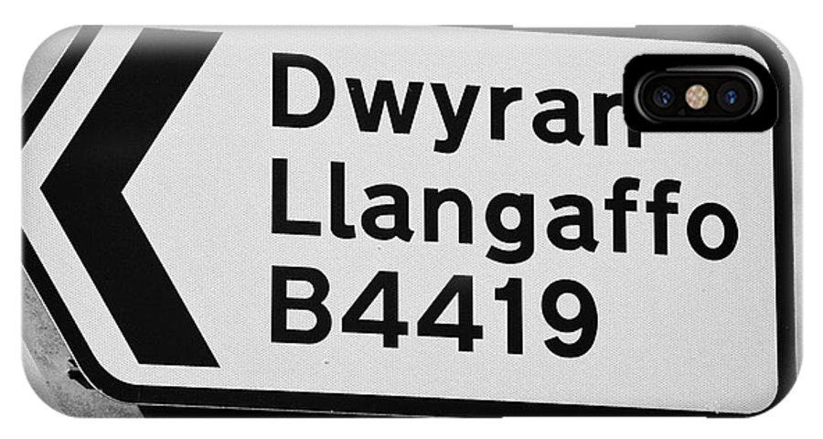 Welsh IPhone X / XS Case featuring the photograph Welsh Rural Roadsign For B Road On Anglesey Wales Uk by Joe Fox
